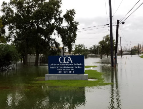Photo of the Gulf Coast Waste Disposal Authority sign with flooding from Hurricane Harvey
