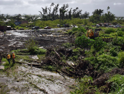 Photo of debris from Hurricane Maria in Puerto Rico and clean up team